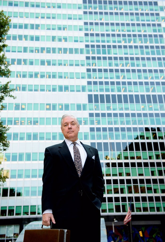 Stock Photo: 1439R-1147453 Businessman with briefcase in front of glass building