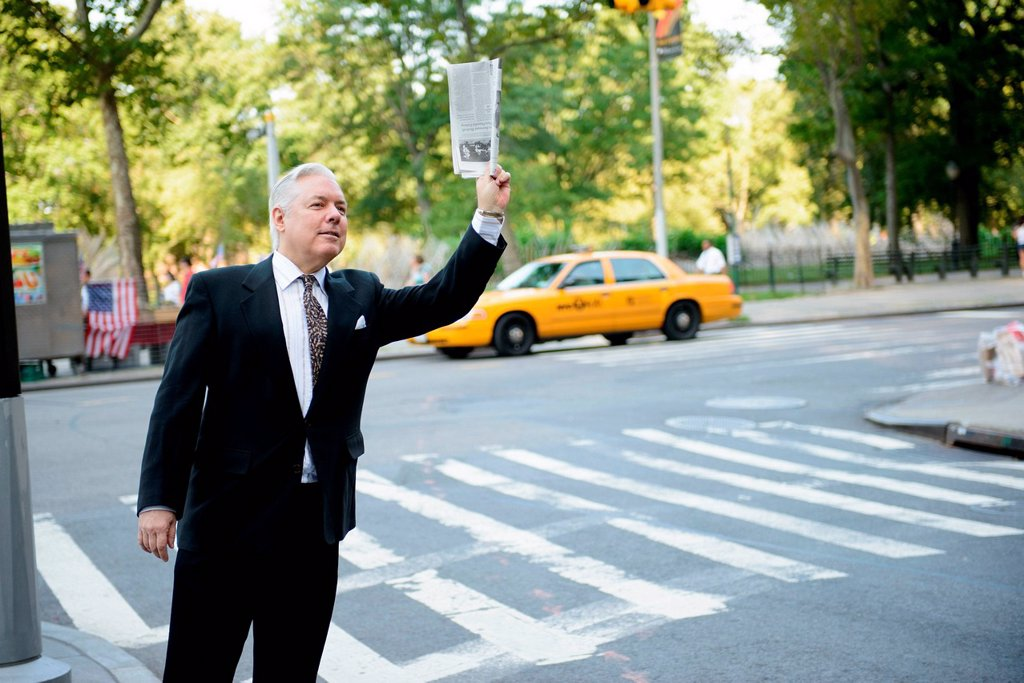 Businessman hailing a cab in New York City : Stock Photo