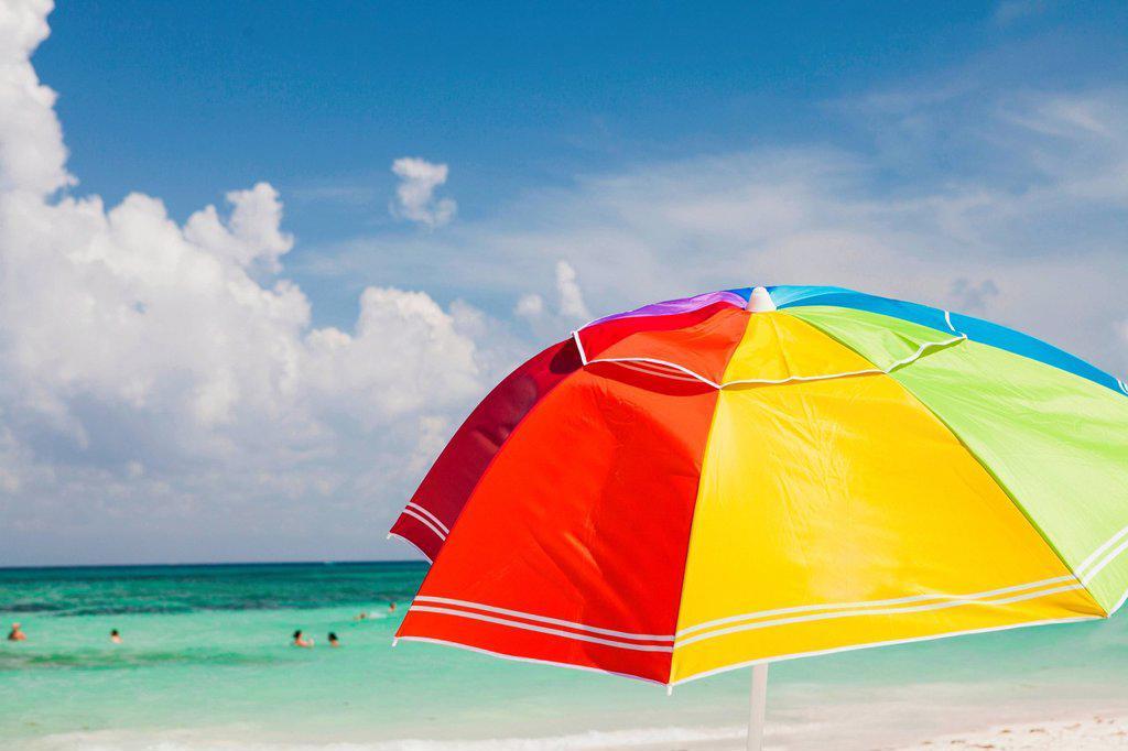 Bright beach umbrella on Playa Del Carmen, Quintana Roo, Mexico : Stock Photo