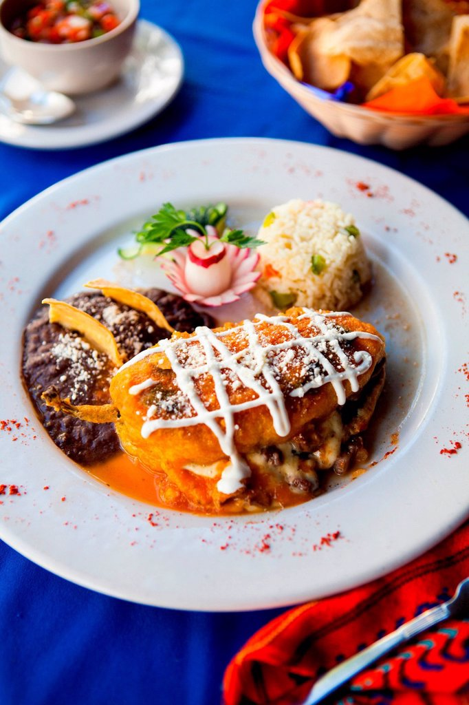 Stock Photo: 1439R-1147477 Traditional Mayan dish of stuffed pepper with rice and beans