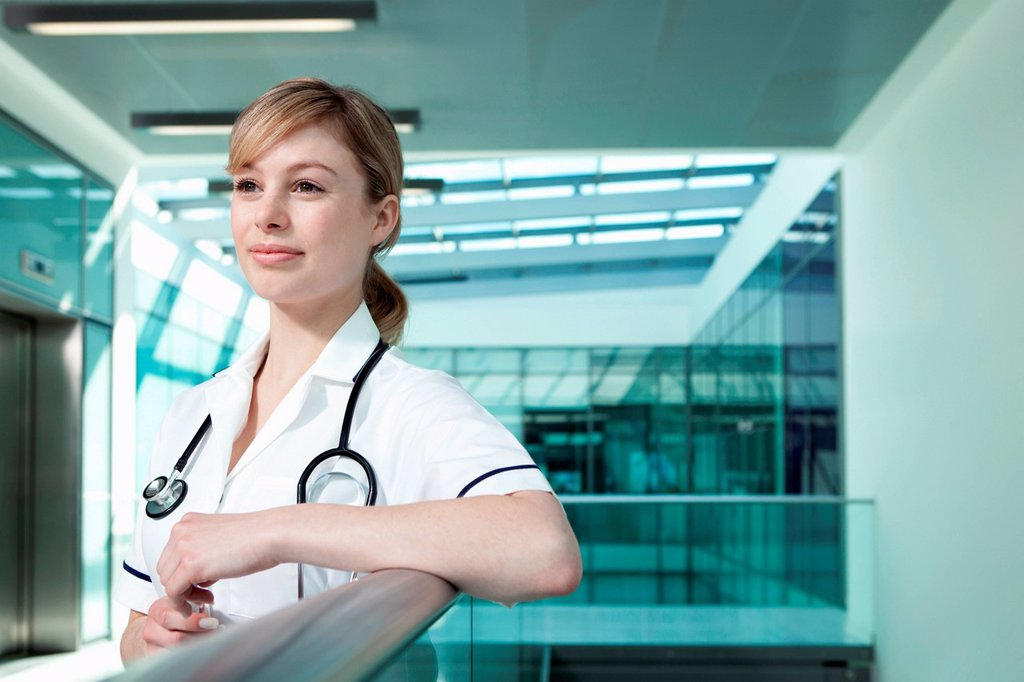 Stock Photo: 1439R-1147497 Portrait of nurse leaning on railing
