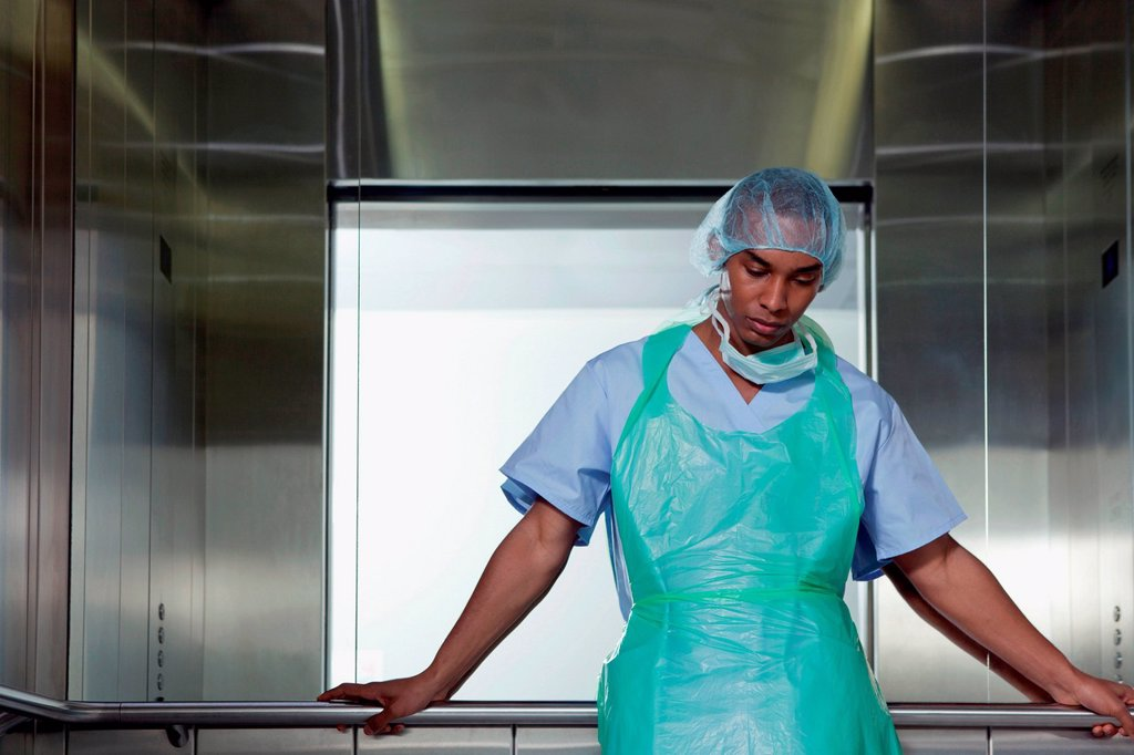 Stock Photo: 1439R-1147505 Portrait of surgeon in hospital elevator
