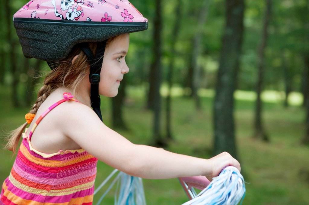 Stock Photo: 1439R-1147514 Girl cycling