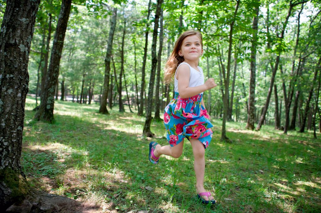 Stock Photo: 1439R-1147524 Girl running in forest
