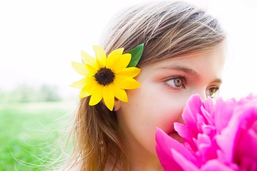 Stock Photo: 1439R-1147534 Girl with pink flower