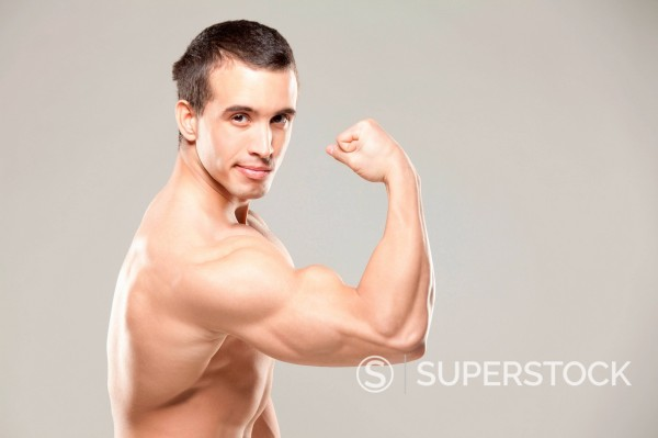 Bodybuilder flexing muscles : Stock Photo