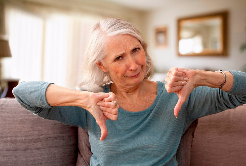 Stock Photo: 1439R-1147582 Senior woman with thumbs down