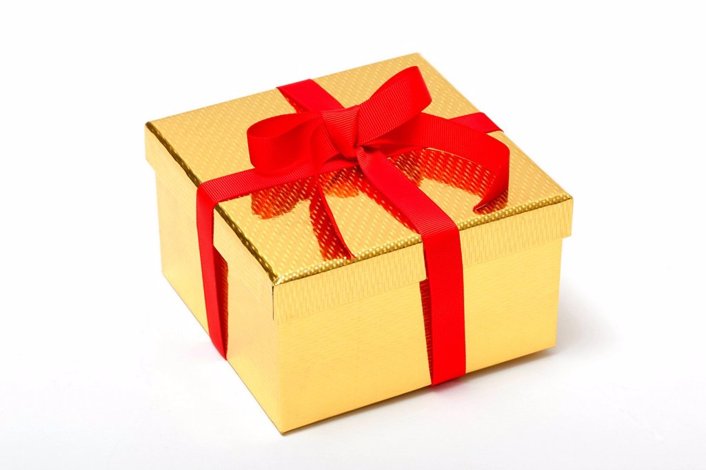 Stock Photo: 1439R-1147651 Golden gift box with red ribbon