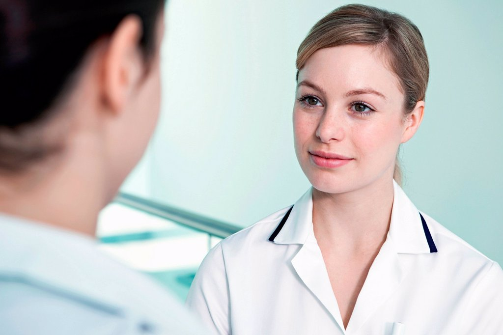Stock Photo: 1439R-1147714 Nurse listening to colleague