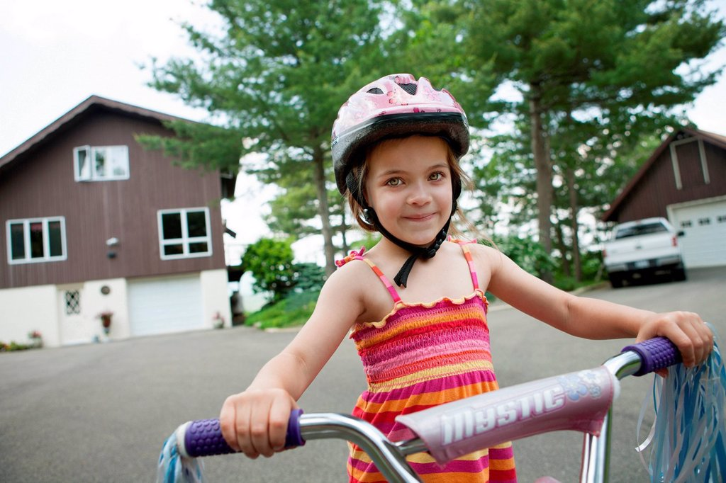 Stock Photo: 1439R-1147729 Girl on bicycle