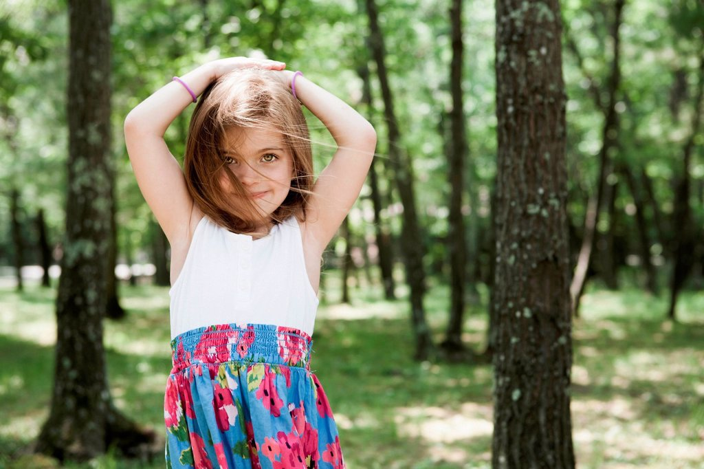 Stock Photo: 1439R-1147735 Girl in forest, hand in hair