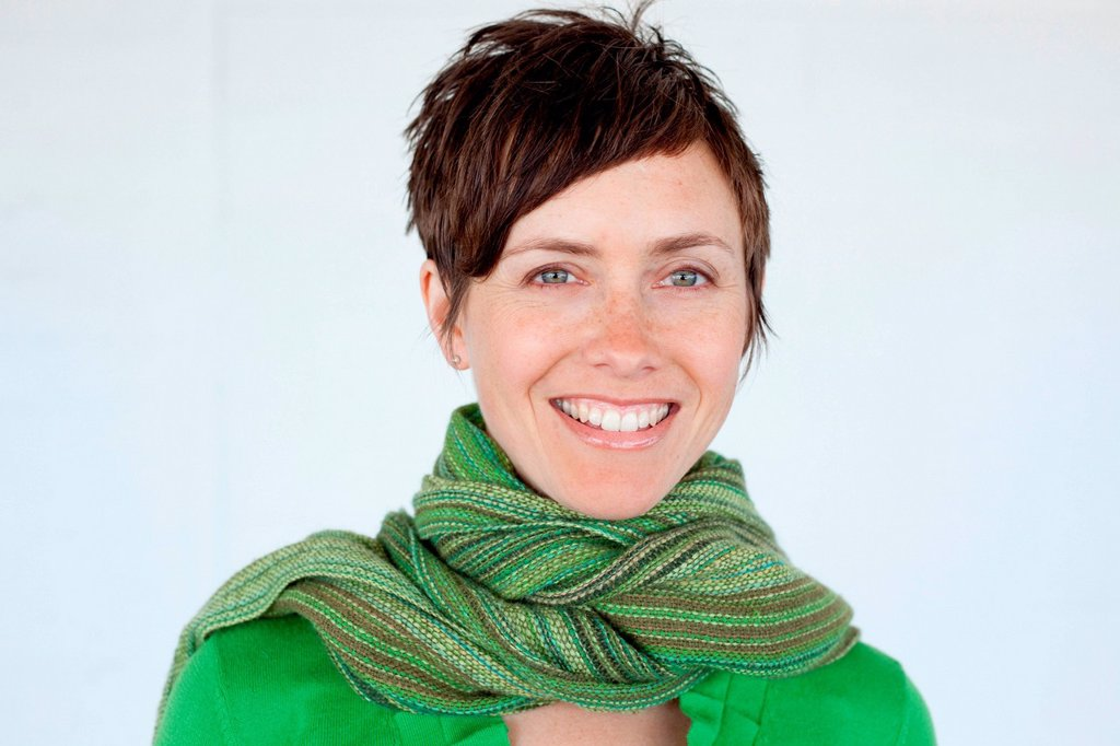 Woman wearing green scarf, portrait : Stock Photo