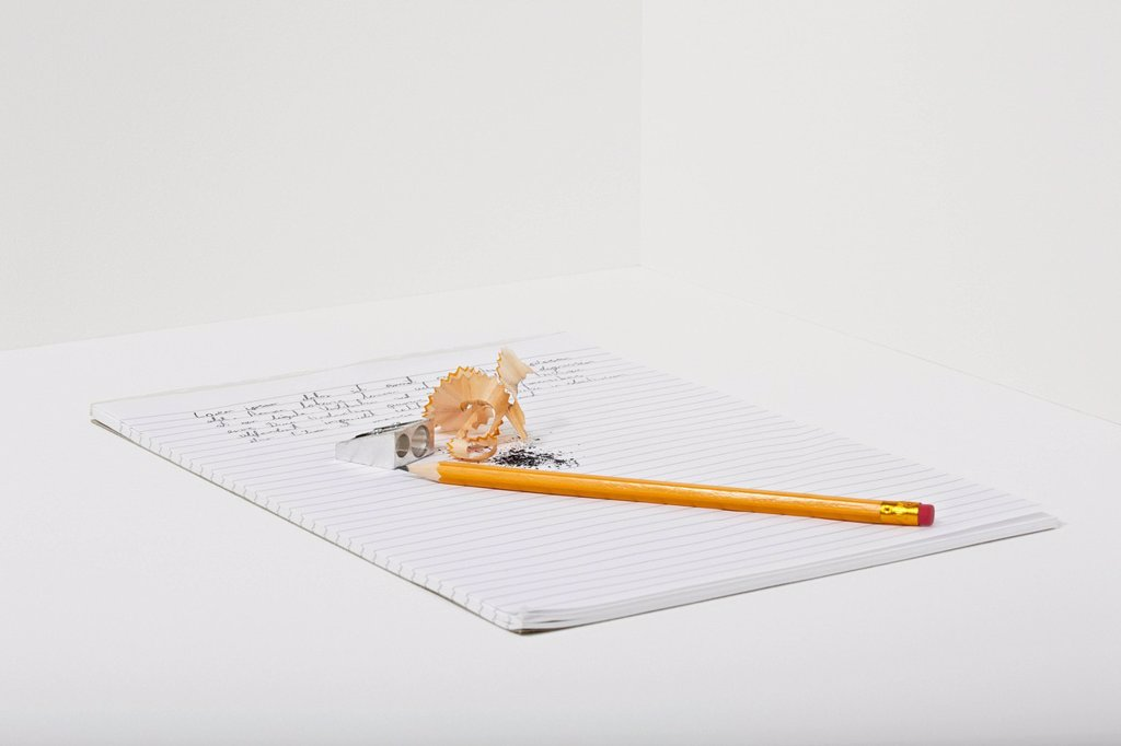 Stock Photo: 1439R-1147777 Notebook, pencil and pencil shavings