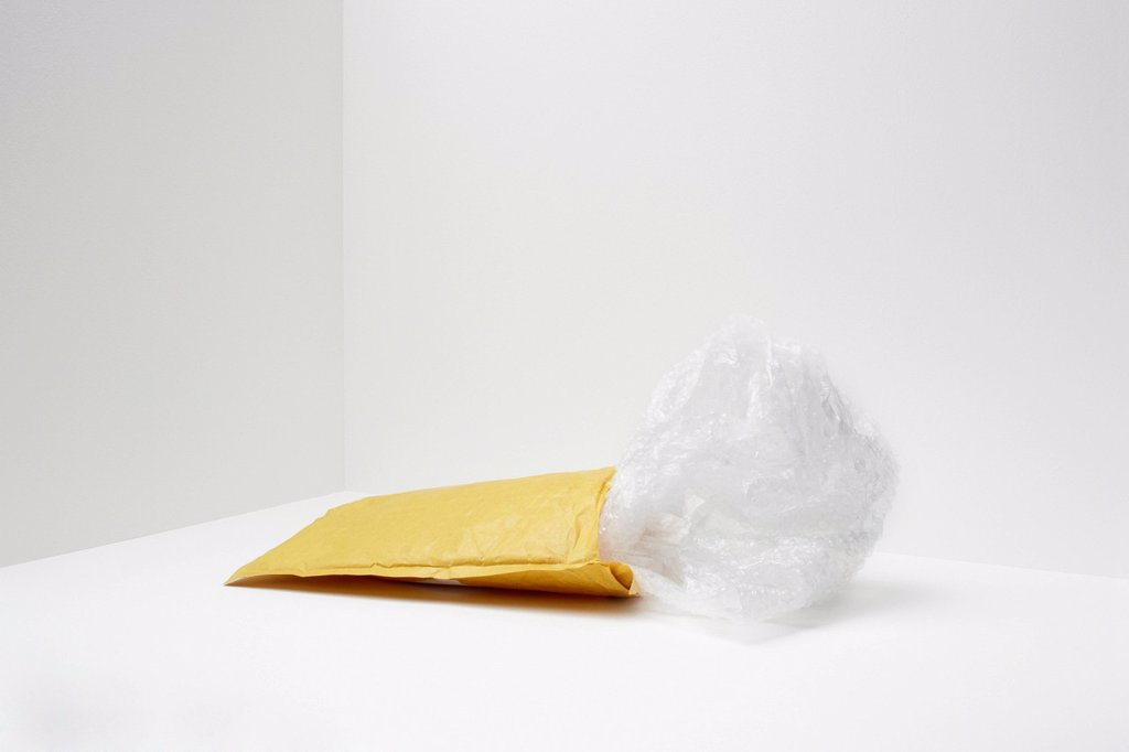 Stock Photo: 1439R-1147785 Padded envelope with plastic coming out