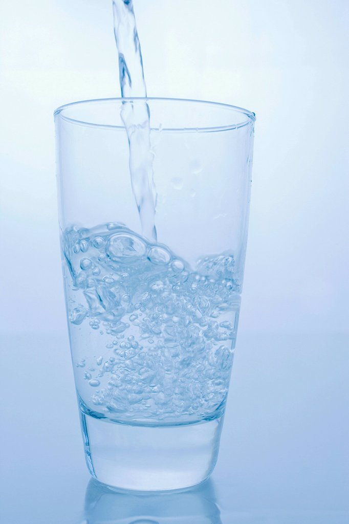 Stock Photo: 1439R-1147830 Pouring glass of water