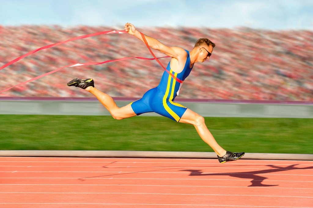 Runner crossing the finish line : Stock Photo