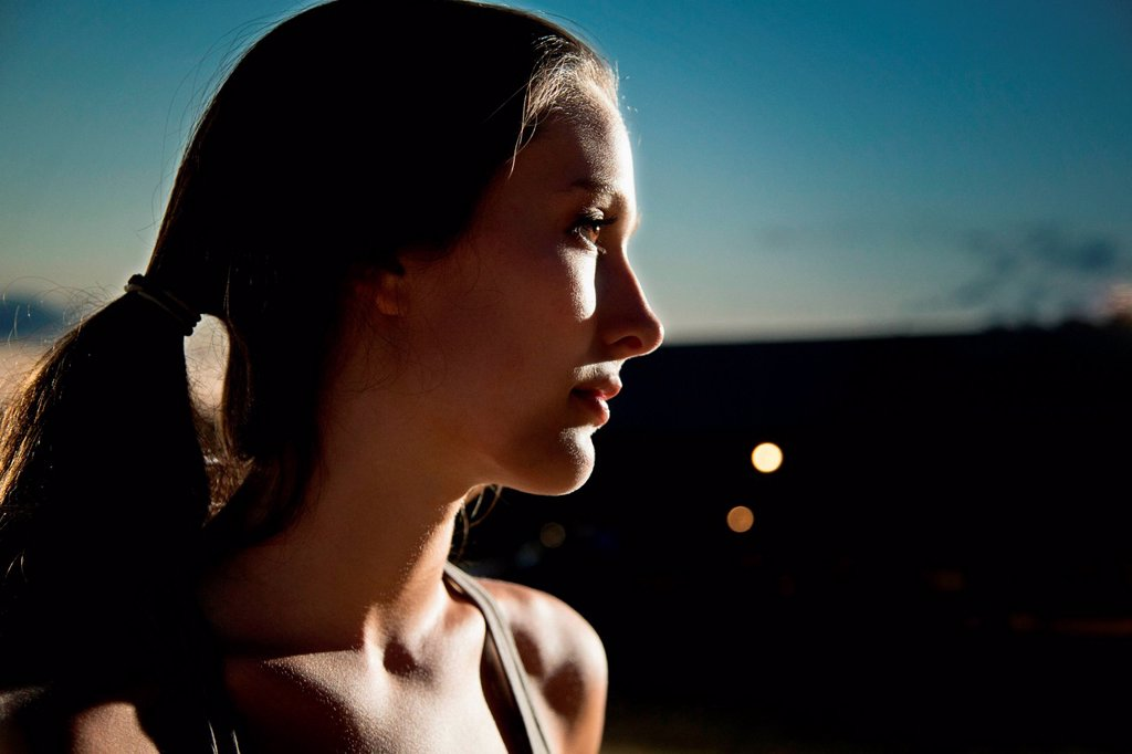 Portrait of girl looking away, at night : Stock Photo
