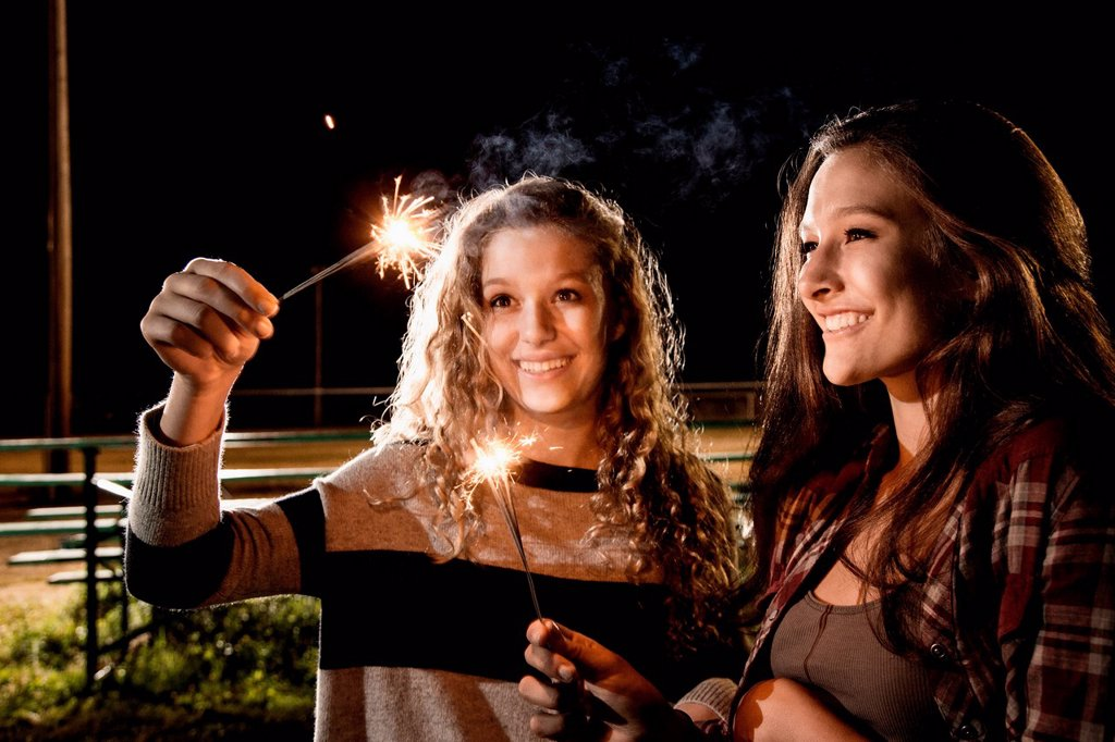 Stock Photo: 1439R-1147918 Friends holding sparklers