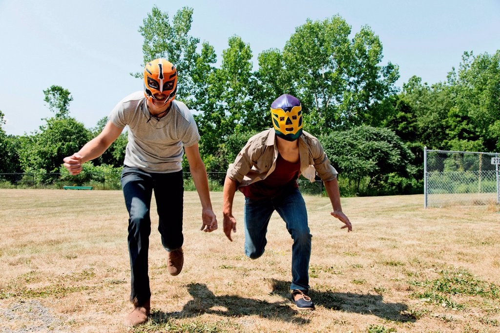 Stock Photo: 1439R-1147941 Two young men wearing wrestling masks