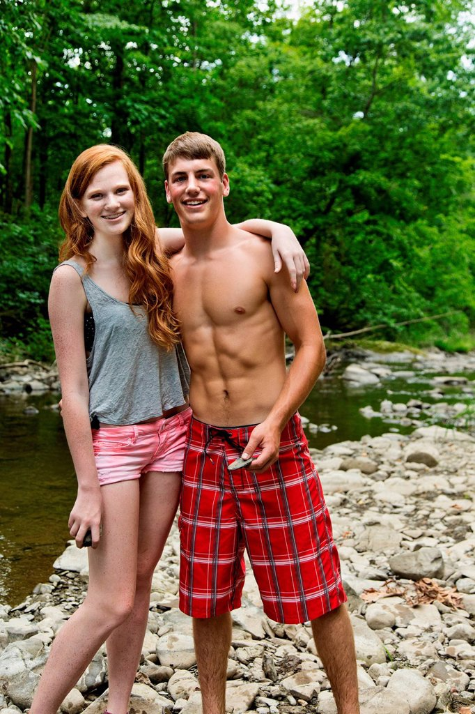 Stock Photo: 1439R-1147958 Couple standing by river, portrait