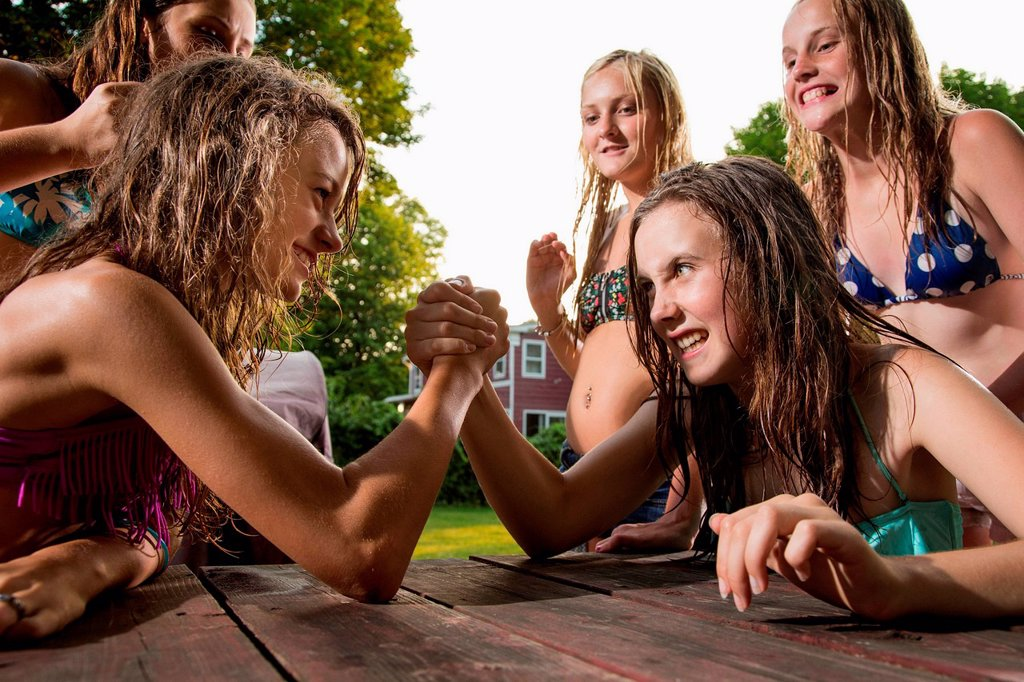 Two girls arm wrestling : Stock Photo