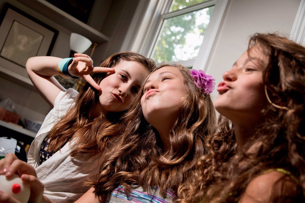 Three girls pulling faces : Stock Photo