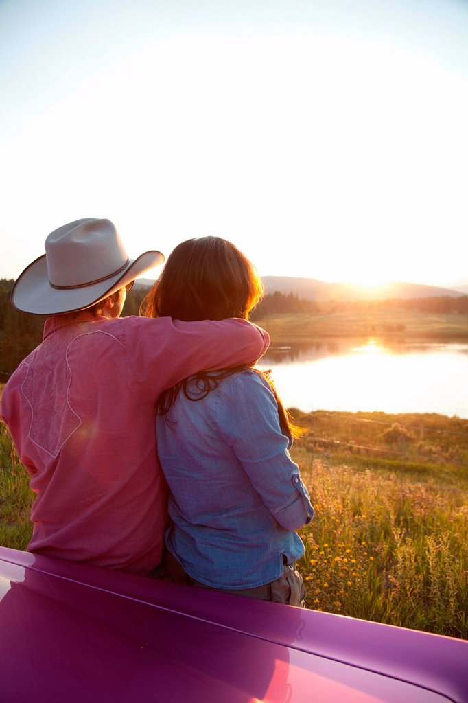 Couple looking at sunset : Stock Photo