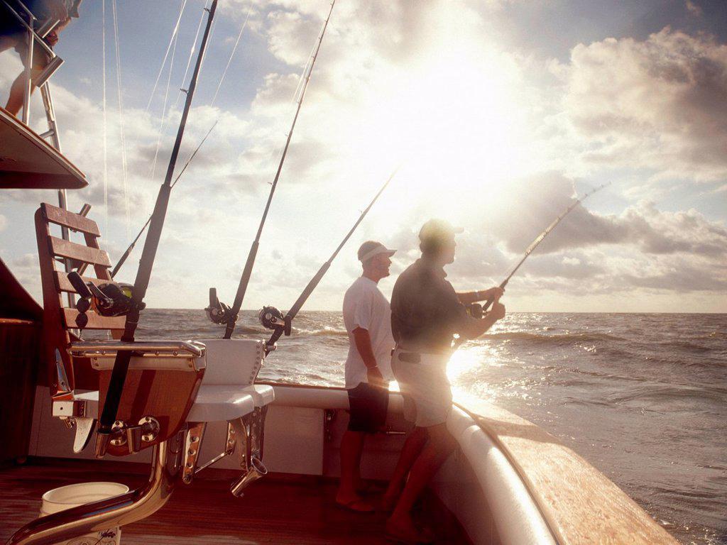 Stock Photo: 1439R-1148209 Men fishing from sport fishing boat
