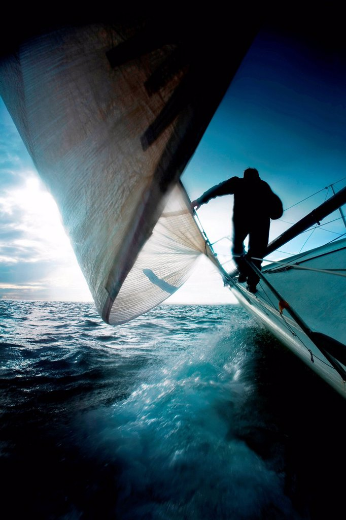 Silhouette of man on sailing boat : Stock Photo