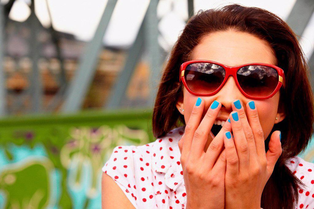 Stock Photo: 1439R-1148377 Teenage girl in sunglasses, looking shocked