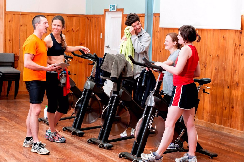 Stock Photo: 1439R-1148462 People talking after spinning class