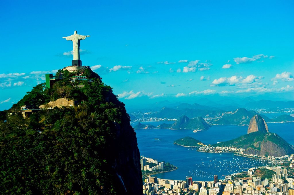 Stock Photo: 1439R-1148480 Christ the Redeemer statue overlooking Rio de Janeiro and Sugarloaf Mountain, Brazil