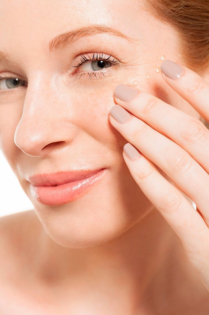 Woman applying eye gel : Stock Photo