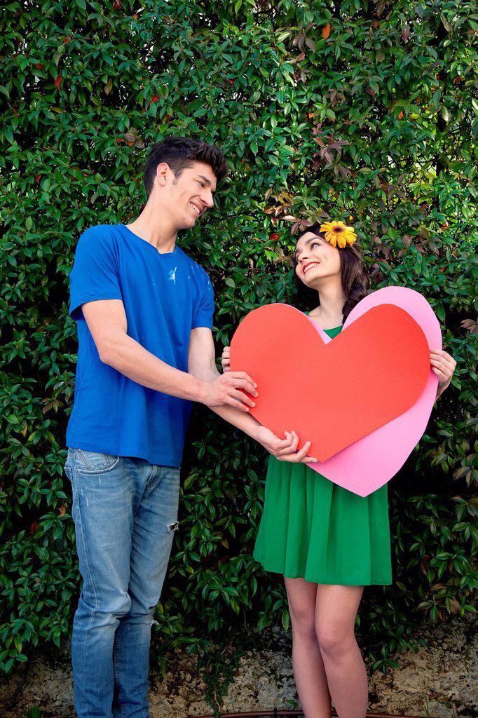 Couple holding heart shape : Stock Photo