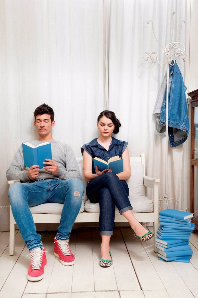 Couple reading books : Stock Photo