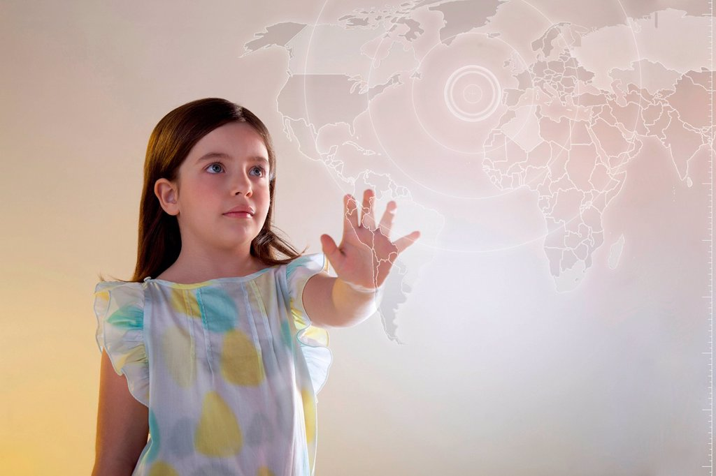 Stock Photo: 1439R-1148720 Girl touching virtual world map