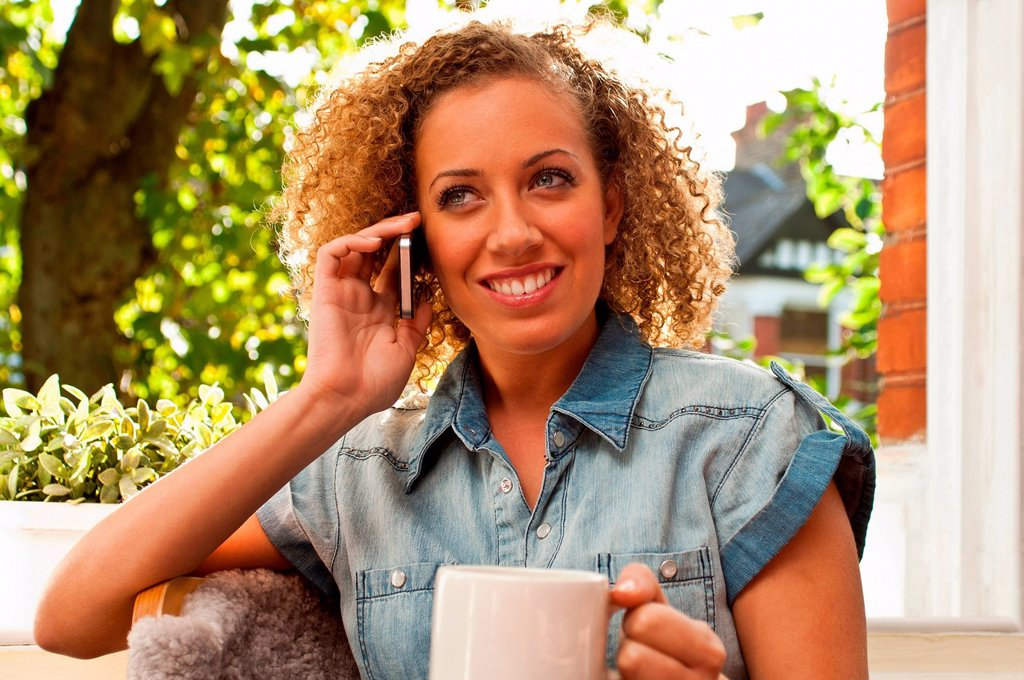 Stock Photo: 1439R-1148851 Woman on cell phone
