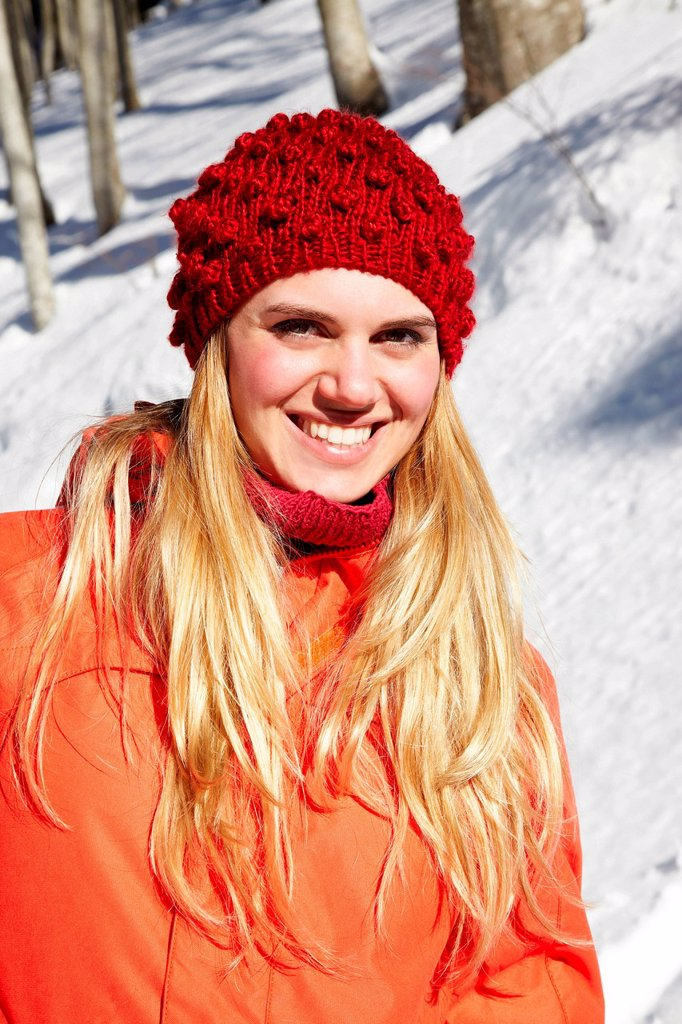 Stock Photo: 1439R-1148908 Portrait of woman wearing red knit hat and coat