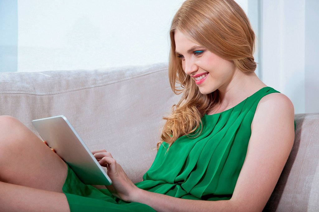 Young woman using digital tablet : Stock Photo