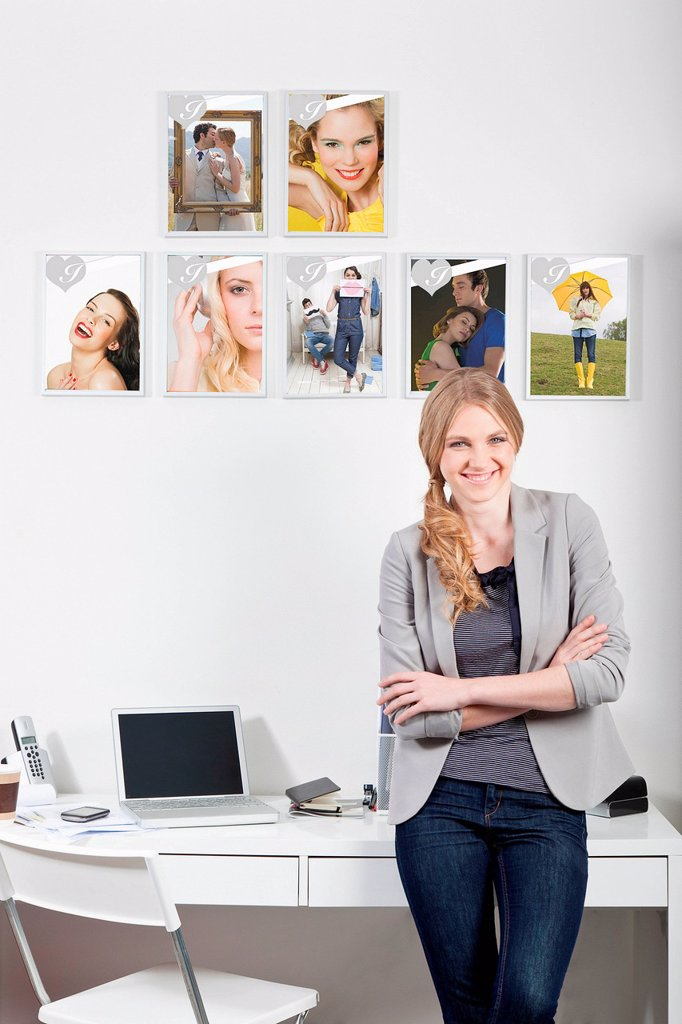 Confident young woman in magazine office : Stock Photo