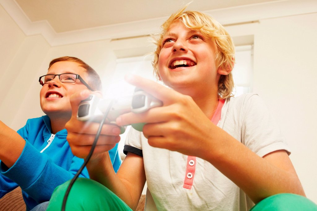 Stock Photo: 1439R-1149028 Two boys playing video game