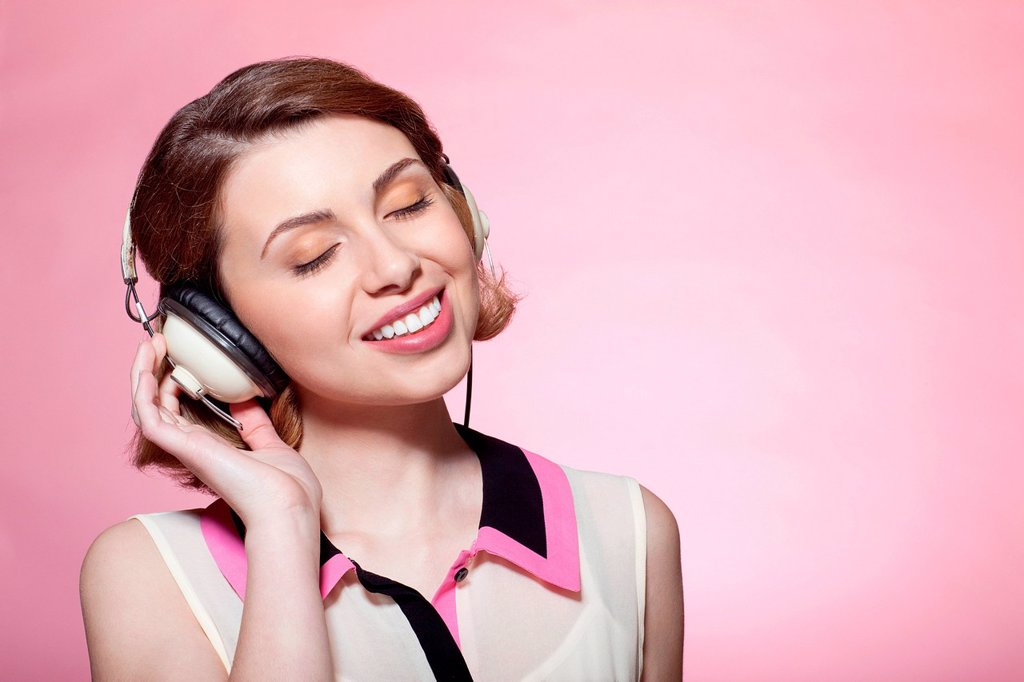 Stock Photo: 1439R-1149076 Woman wearing headphones