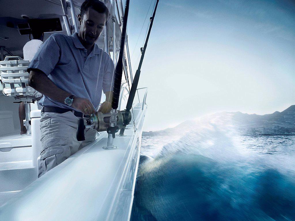Man fishing from yacht : Stock Photo