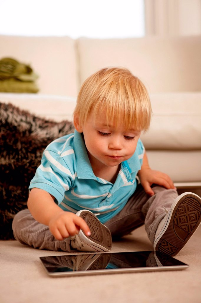 Stock Photo: 1439R-1149218 Boy using digital tablet