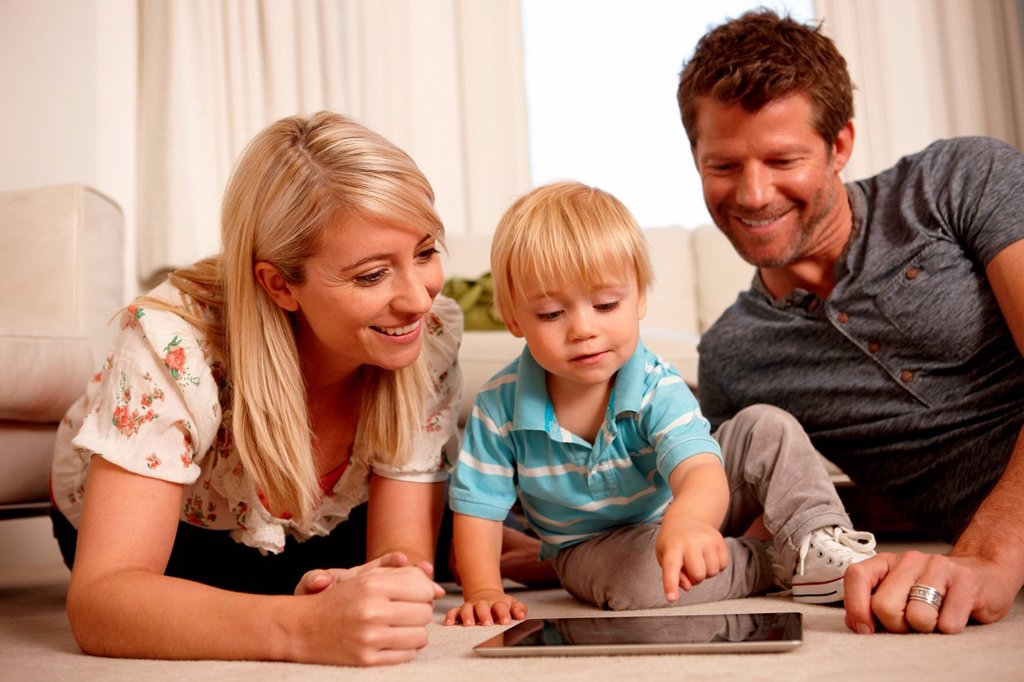 Father, mother and son using digital tablet : Stock Photo