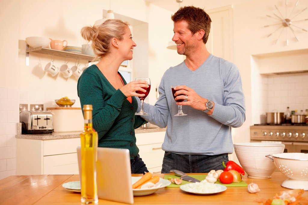 Couple preparing food in kitchen : Stock Photo