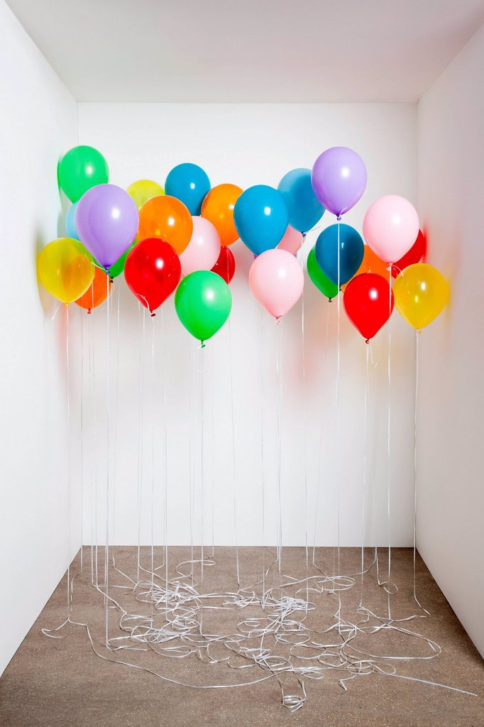 Stock Photo: 1439R-1149833 Colorful balloons in a room