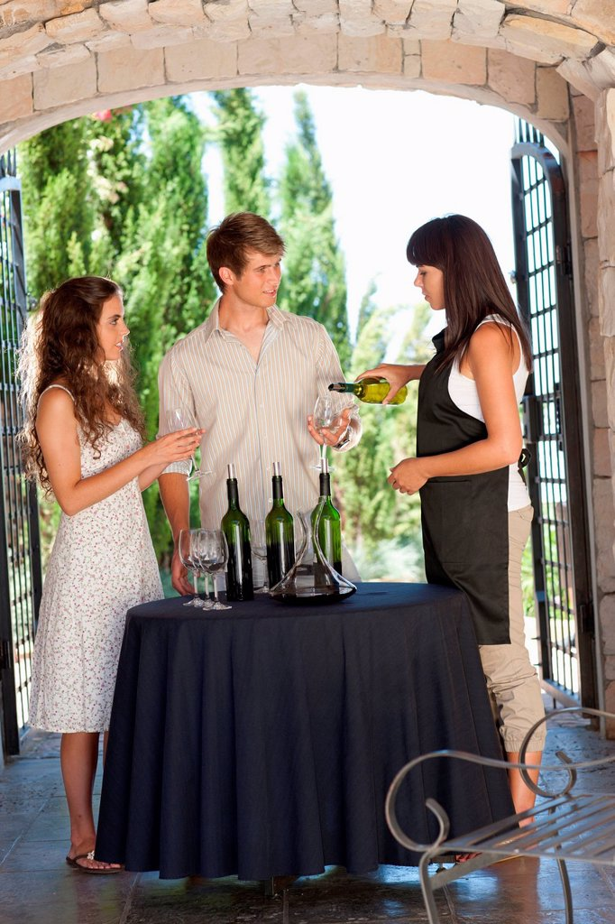Stock Photo: 1439R-1151680 Couple tasting wine in doorway