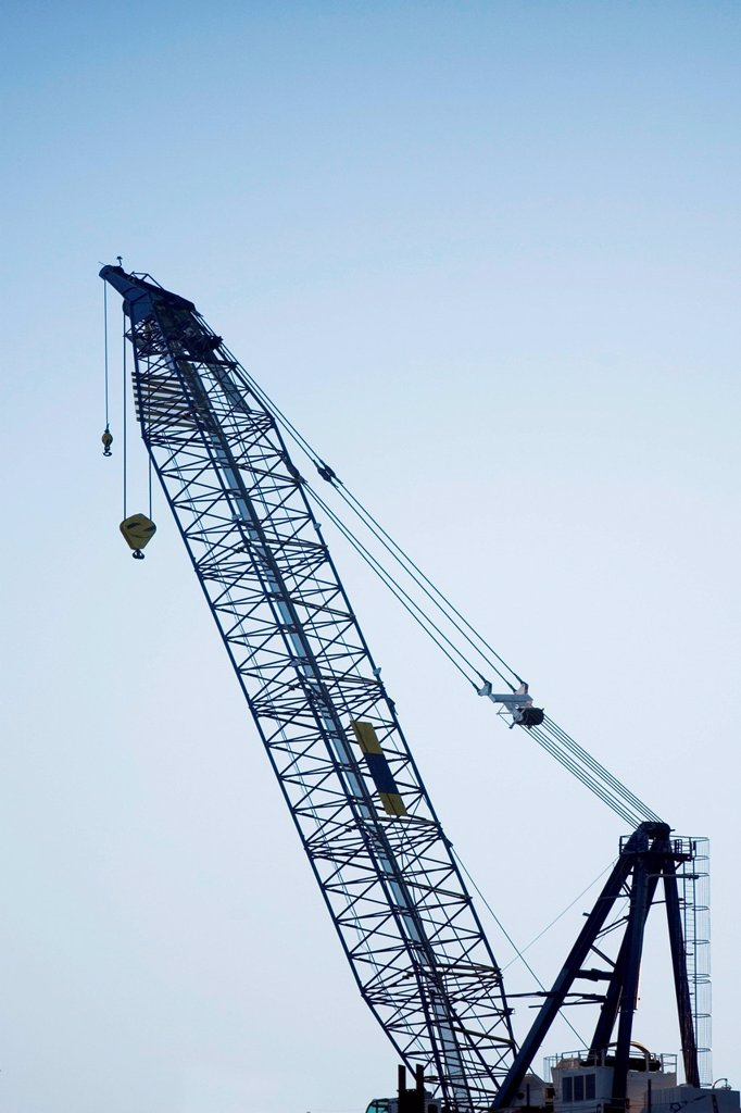 Stock Photo: 1439R-1152439 Silhouette of crane against sky