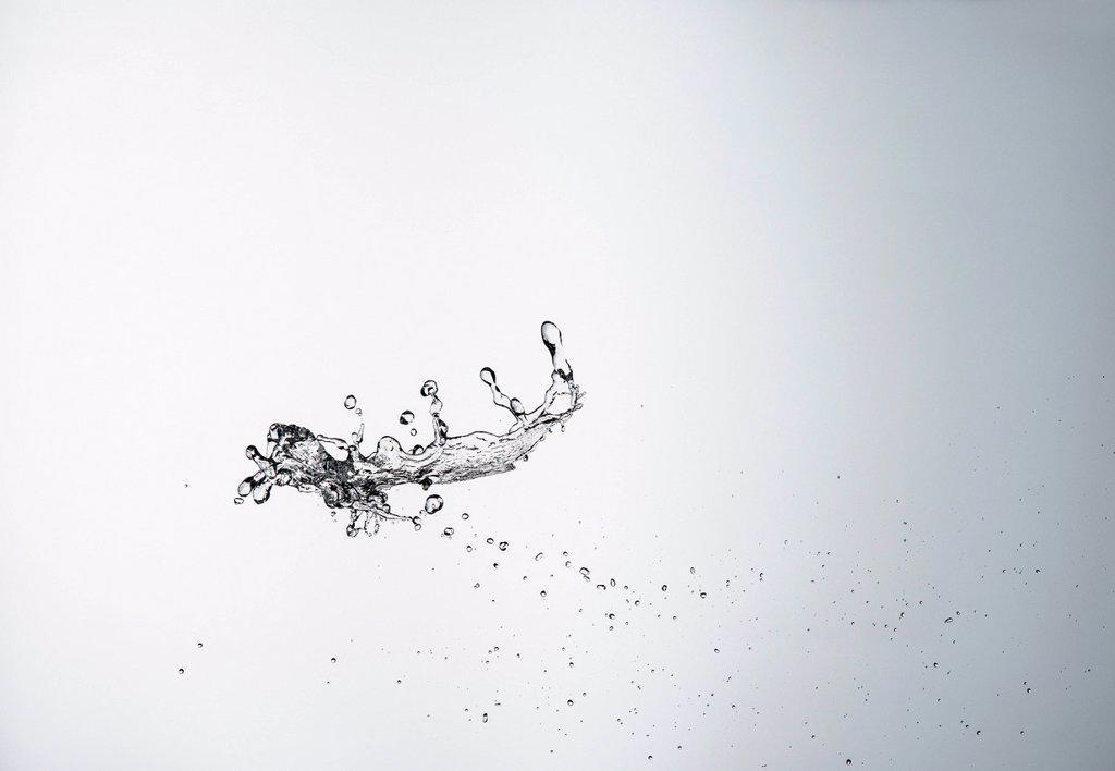 Water splashing in air : Stock Photo